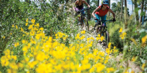 Women Mountain Biking Flowers Crested Butte